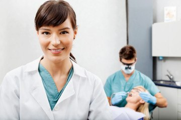 photodune-3832683-female-assistant-with-dentist-working-in-the-background-s