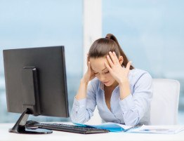 photodune-7064563-stressed-woman-with-computer-and-documents-s